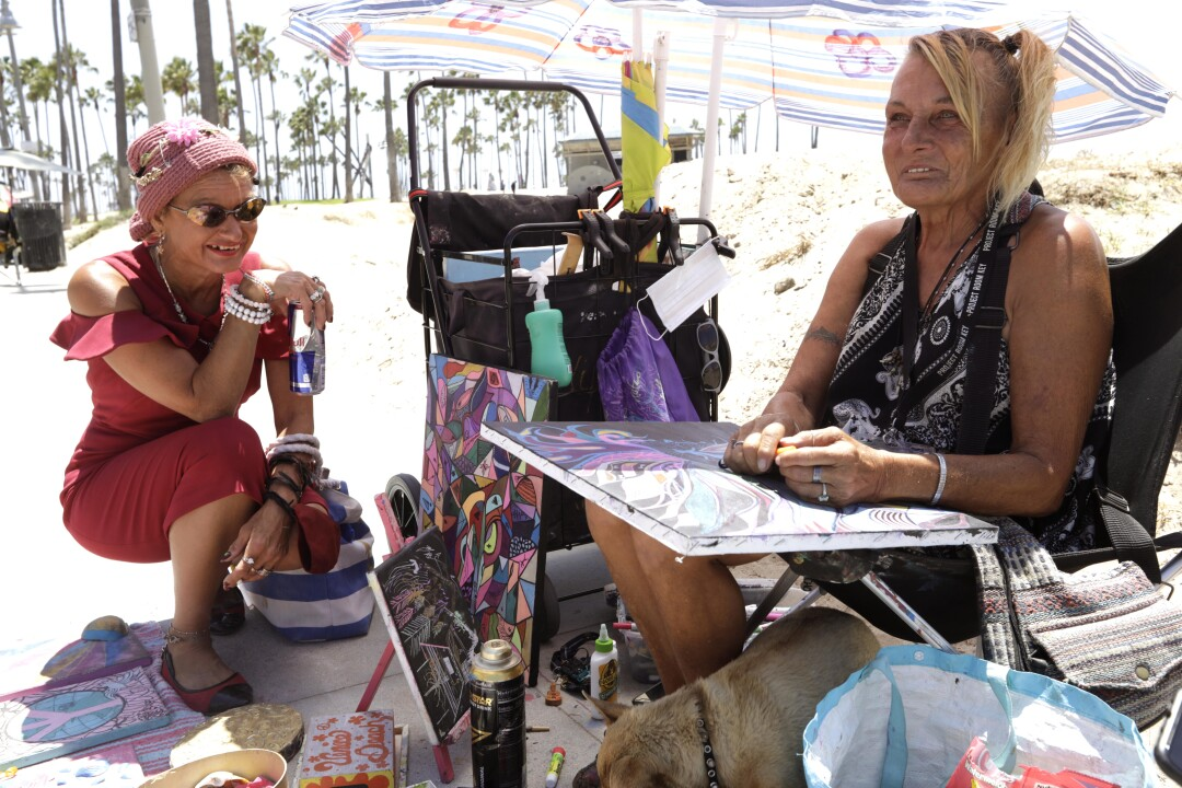 Teresa Robles,  right, and Dixie Moore, who were homeless near this spot on Ocean Front Walk, now have a room at a hotel