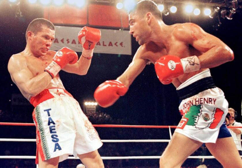 Oscar de la Hoya throws a punch against Julio Cesar Chavez