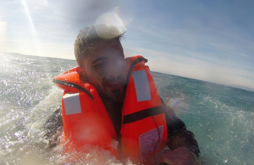 In this Monday, Feb. 8, 2016 photo made available by the Turkish Coast Guard, Pelen Hussein, a Syrian migrant, 20, who was trying to reach Greece when the boat he was in capsized, is being rescued by the Turkish Coast Guard Air Command off the waters of Edremit bay in the Aegean Sea, Turkey. Turkey