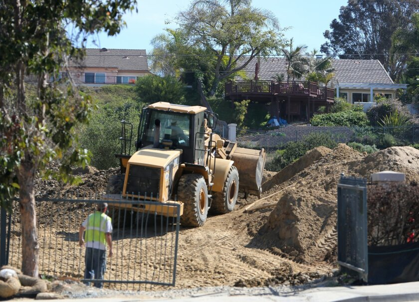Some residents on Mimosa Drive in Carlsbad are upset that houses to be built on Rock Dove Street may block their view of Batiquitos Lagoon.