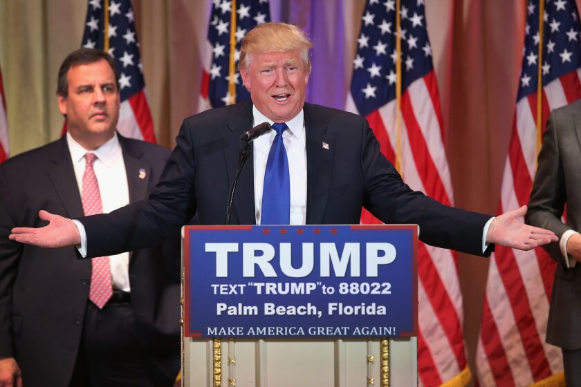 Donald Trump, forgoing the customary election night victory party, addresses reporters at a news conference at his Mar-a-Lago Club in Palm Beach, Fla. With him is New Jersey Gov. Chris Christie.