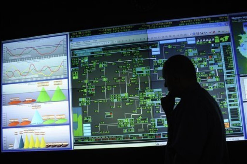 A system engineer of the FGSZ Ltd, Hungary's natural gas transporting company, checks the screens showing the country's gas pipeline system in Siofok, Hungary, Saturday, Jan. 10. 2009. Hungary is using its gas reserves from storage facilities as Russia's gas shipments to Europe via Ukraine stopped