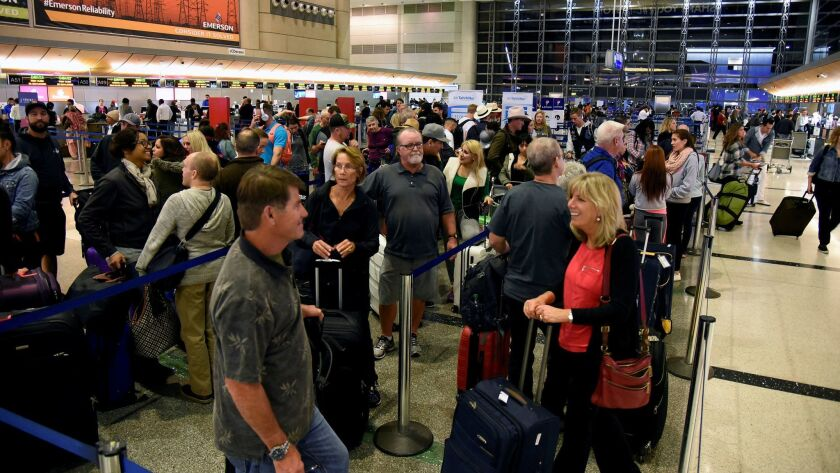 Thanksgiving holiday travelers last year queue inside Tom Bradley International Terminal at Los Angeles International Airport in Los Angeles.