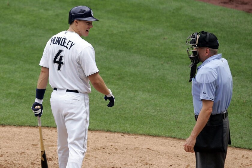 Nick Hundley of the Padres has words with umpire Mike Everitt after striking out in the second inning against the Giants.