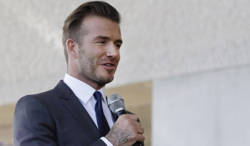 Former Galaxy star David Beckham announces at a news conference Wednesday that he will exercise his option to purchase a Major League Soccer expansion team in Miami.