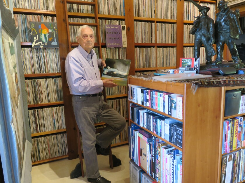 Bram Dijkstra is shown with some of his nearly 50,000 albums.