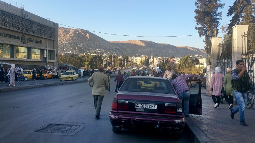 A busy thoroughfare near Damascus University.