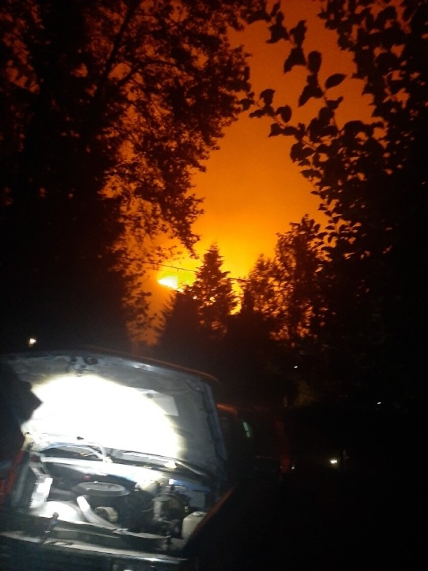 Before he fled on Monday, Troy Rethaford snapped a photo of the Holiday Farm wildfire approaching his house in Rainbow, Ore.