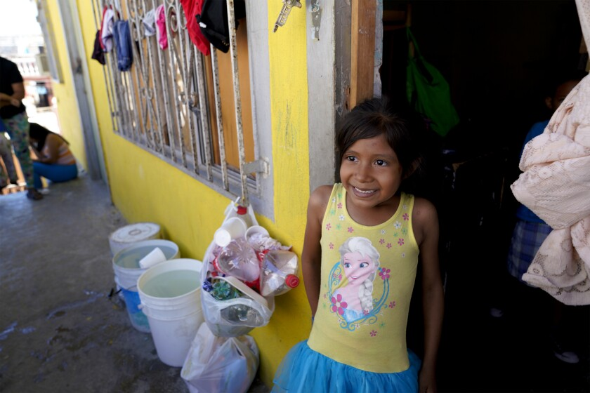 Fernanda Martinez, 6 from Honduras stands at the doorway to the room where she and her mother, Jasmine Martinez, 34 were quarantined to because they had chicken pox. As of August 15th the two are free to move about the shelter at the Agape World Mission shelter in Tijuana, Mexico.