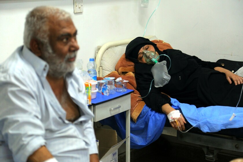A coronavirus patient receives treatment at a hospital in Najaf, Iraq, Wednesday, July 14, 2021. Infections in Iraq have surged to record highs amid a third wave spurred by the more aggressive delta variant, and long-neglected hospitals suffering the effects of decades of war are overwhelmed with severely ill patients, many of them young people. (AP Photo/Anmar Khalil)
