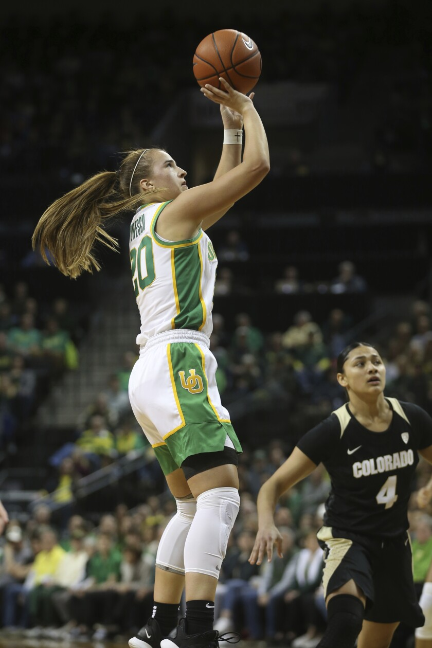 Oregon's Sabrina Ionescu shoots over Colorado's Lesila Finau during the second quarter of an NCAA college basketball game in Eugene, Ore., Friday, Jan. 3, 2020. (AP Photo/Chris Pietsch)