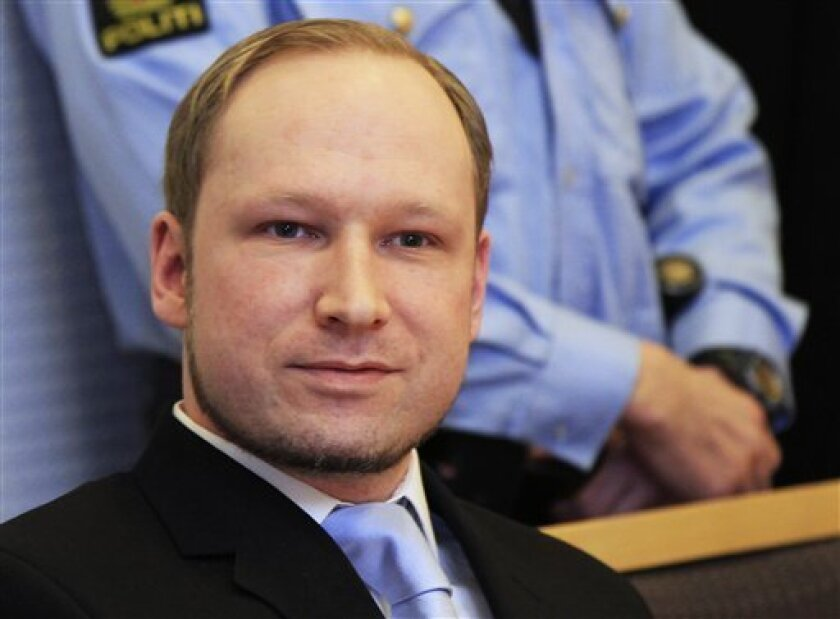 Anders Behring Breivik, a right-wing extremist who confessed to a bombing and mass shooting that killed 77 people on July 22, 2011, arrives for a detention hearing at a court in Oslo, Norway, Monday, Feb. 6, 2012. About 100 survivors and relatives of the victims of the July 22 massacre attended the hearing in Oslo's district court - expected to decide to keep Breivik in jail until his trial begins in April. (AP Photo/Lise Aserud, Scanpix Norway) NORWAY OUT