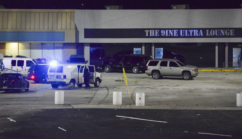 Kansas City, Mo., police crime scene investigators gather evidence early Monday at the scene of a shooting at a nightclub.