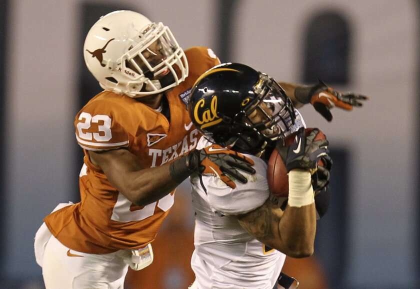 Cals Keenan Allen hauls in this 19 yard pass play as Carrington Byndom defends for Texas