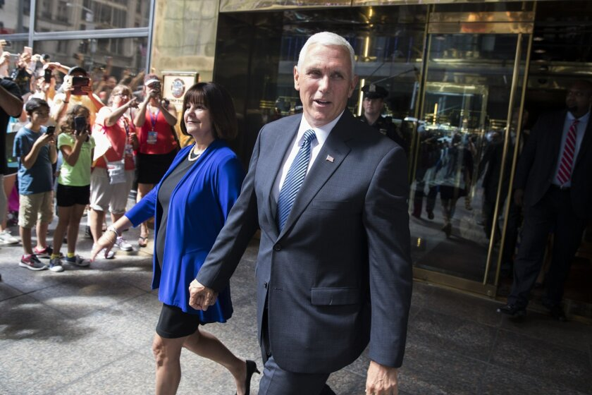 Indiana Gov. Mike Pence and his wife Karen leave a meeting with Republican presidential candidate Donald Trump at Trump Tower in New York, Friday, July 15, 2016. (AP Photo/Evan Vucci)