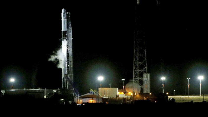 A SpaceX Falcon 9 remains on space launch complex 40 after a scrubed launch attempt to deliver suppl