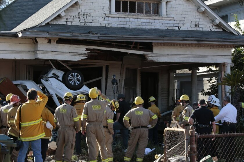 A vehicle crashed into an unoccupied home on Pleasant Avenue in Boyle Heights on Sunday after its occupants were shot at. Two people were dead and another injured after the attack and crash.