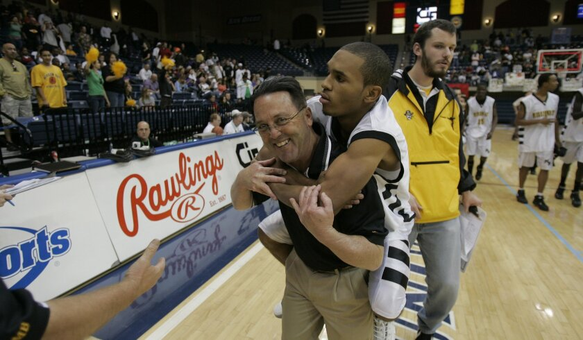 Coach Dennis Kane and his players celebrate a San Diego Section basketball title for Mission Bay in 2007.