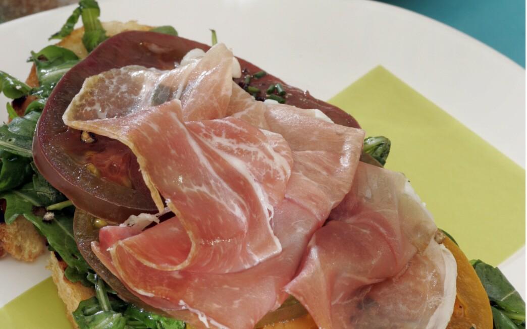 Open-faced arugula, heirloom tomato and prosciutto sandwich