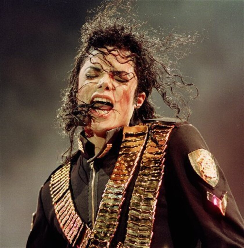 "FILE - In this Aug. 29, 1993 file photo, pop singer Michael Jackson performs during his ""Dangerous"" concert in National Stadium, Singapore. (AP Photo/C.F. Tham, file)"