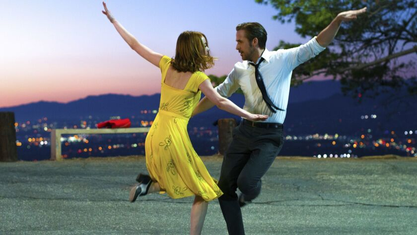 "This image released by Lionsgate shows Ryan Gosling, right, and Emma Stone in a scene from, ""La La L"