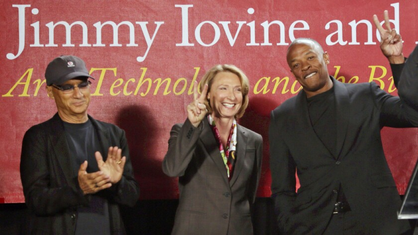 Roski Dean Erica Muhl with Jimmy Iovine and Dr. Dre at the opening of the Jimmy Iovine and Andre Young Academy for Arts and Technology and Business Innovation in 2013.
