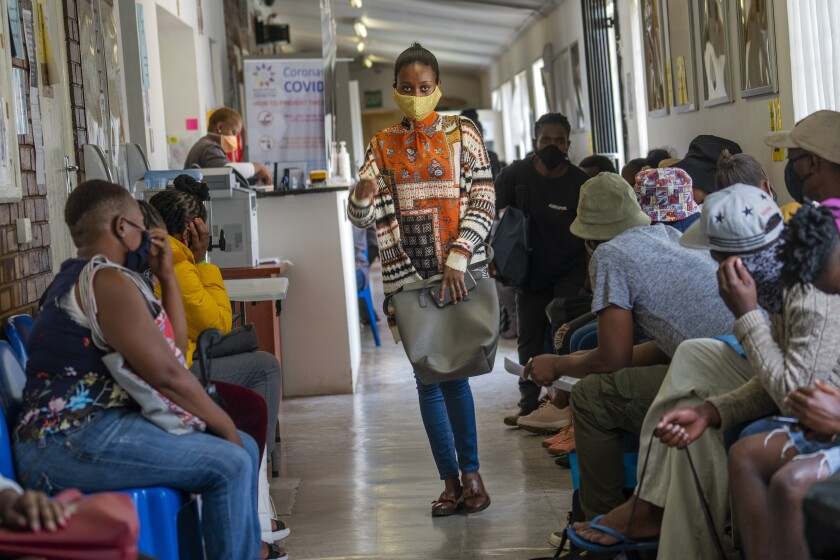 Volunteers wait to be checked at a vaccine trial facility in Soweto, South Africa.