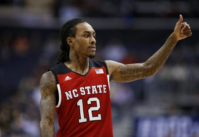 FILE - In this March 9, 2016, file photo, North Carolina State guard Anthony Barber reacts during the first half of the team's NCAA college basketball game in the Atlantic Coast Conference tournament against Duke in Washington. A Wolfpack team spokesman said Tuesday, March 22, that Barber has told coach Mark Gottfried that he plans to remain in the NBA draft instead of returning for his senior season. (AP Photo/Alex Brandon, File)