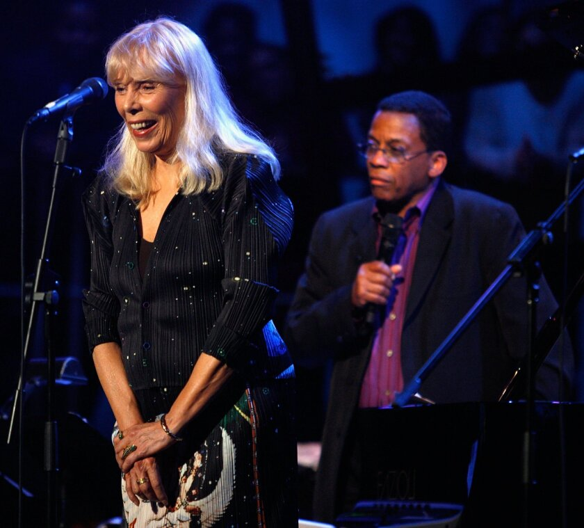 This March 20, 2008 file photo shows longtime friends and  musical collaborators Joni Mitchell, left, and Herbie Hancock on stage in Los Angeles.