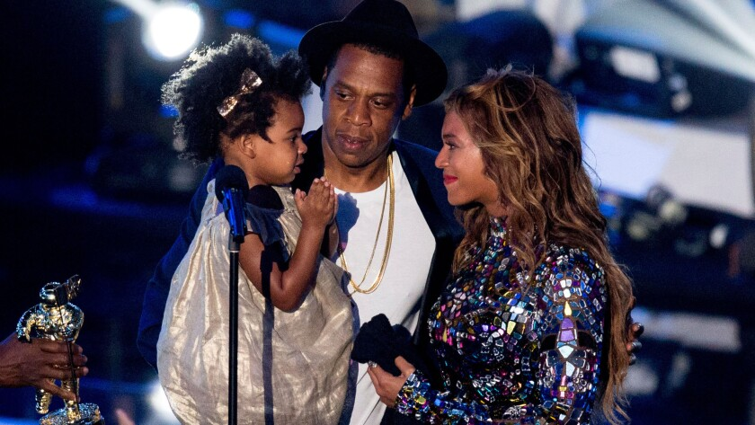 Blue Ivy Carter hit the MTV Video Music Awards stage with father Jay Z after mom Beyonce performed and received the Video Vanguard Award on Sunday.