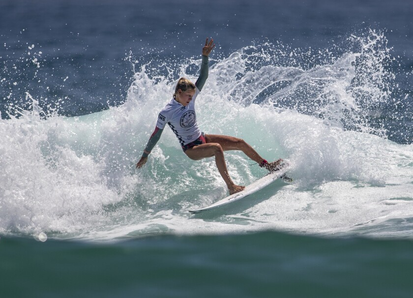 Sanoa Dempfle-Olin does a slashing turn while competing in the women's Junior Tour at the U.S. Open of Surfing.