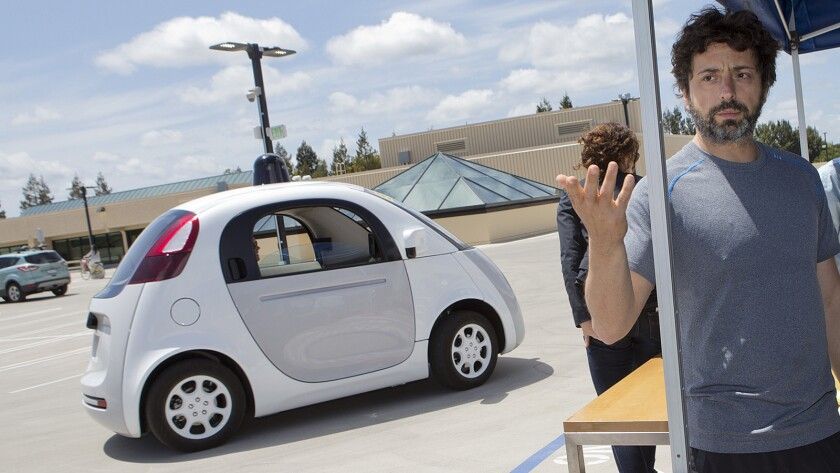 Google co-founder Sergey Brin answers questions about Google's self-driving car program last month in Mountain View, Calif
