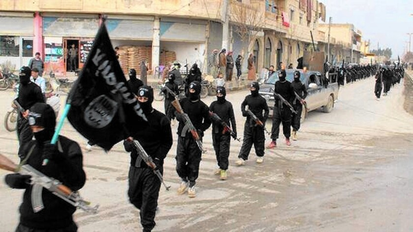 Islamic State fighters march in Raqqah, Syria, in an undated image.