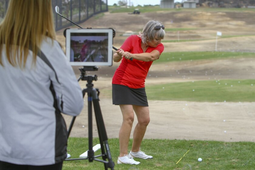 PGA instructor Heidi Richardson (left) takes video of Nancy Wright's golf swing for analysis Sunday during the PGA Women's Golf Festival at Encinitas Ranch Golf Course. Bill Wechter