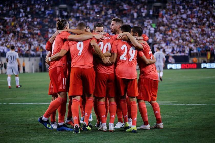 El jugador Marco Asensio del Real Madrid celebra con sus compañeros la anotación de un gol frente a la Roma durante un partido de la Copa Internacional de Campeones entre el Real Madrid y la AS Roma que se juega en el estadio MetLife, en East Rutherford, Nueva Jersey (EE.UU.). EFE