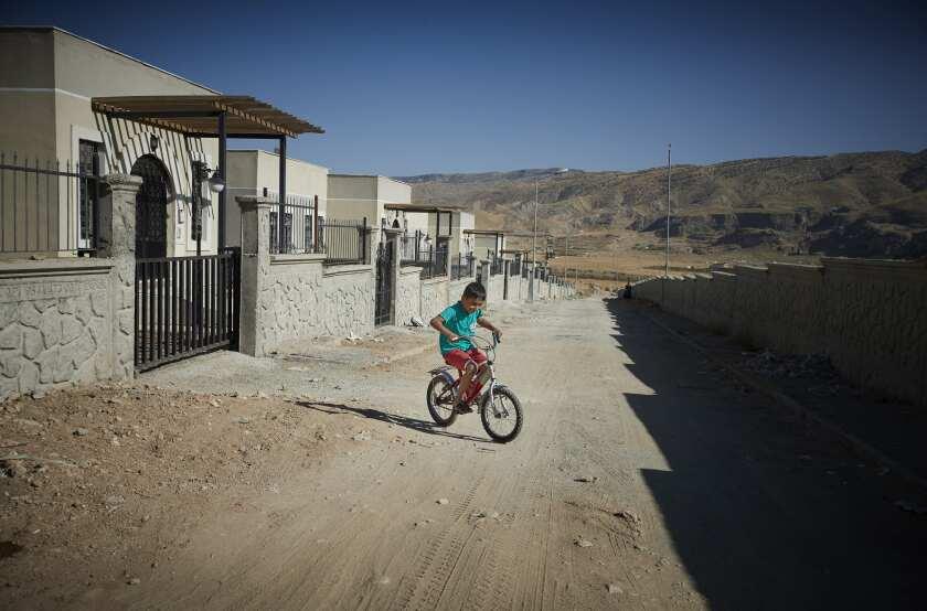 Osman Mahmut rides his bike