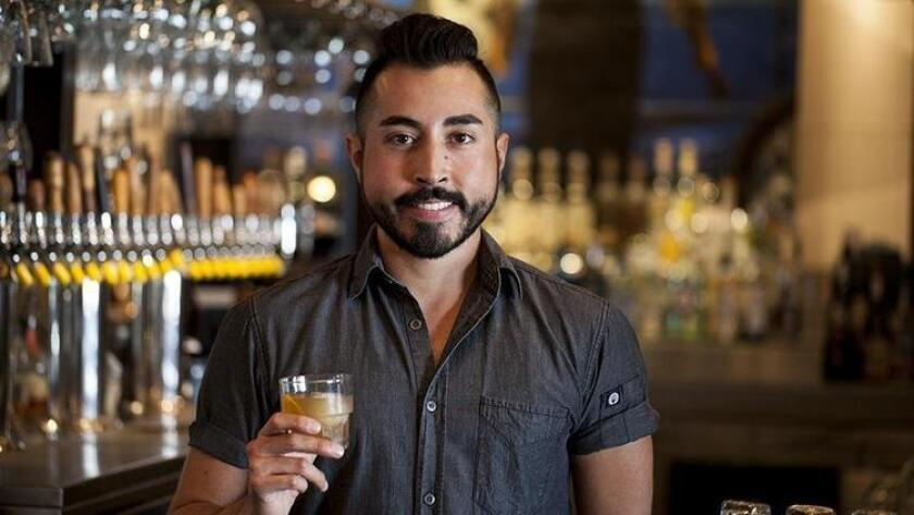 Javi Martinez of OB Warehouse serves up a citrus, peanut-infused bourbon cocktail called Trencher (Jarnard Sutton)
