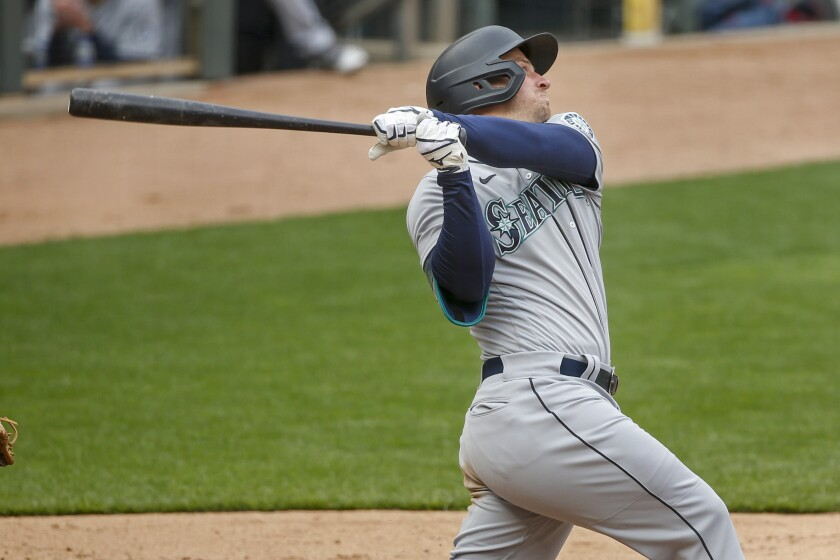Seattle Mariners' Kyle Seager hits a three-run home run against the Minnesota Twins in the ninth inning of a baseball game Sunday, April 11, 2021, in Minneapolis. (AP Photo/Bruce Kluckhohn)