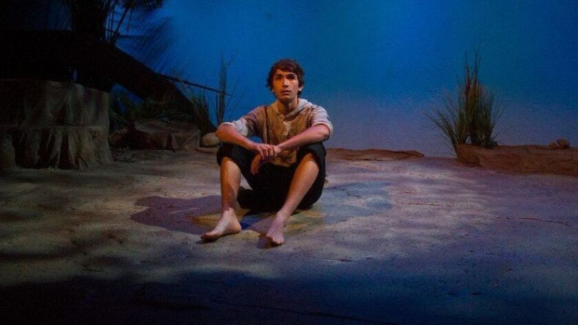 """Canyon Crest basketball player Aaron Acosta performing in """"Lord of the Flies."""""""
