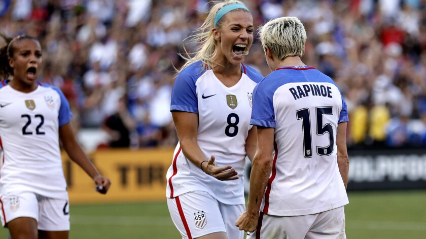 United States midfielder Megan Rapinoe (15) reacts with teammates midfielder Julie Ertz (8), forward