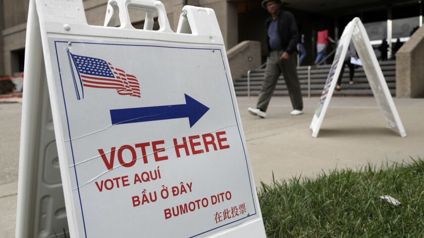 Signs direct voters outside of the Santa Clara County Registrar of Voters on Monday, Oct. 24, 2016,