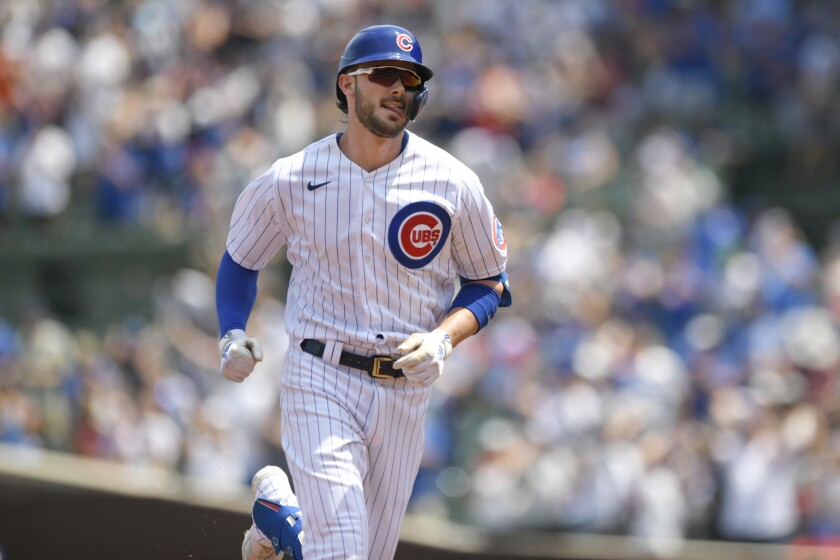 Chicago Cubs' Kris Bryant rounds the bases after hitting a two-run home run during the first inning of a baseball game against the Arizona Diamondbacks Sunday, July 25, 2021, in Chicago. (AP Photo/Paul Beaty)