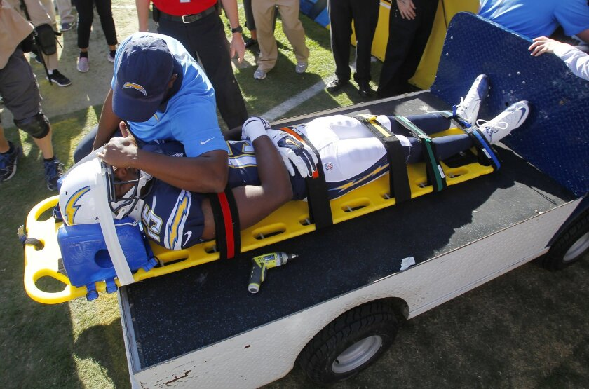 Chargers Dontrelle Inman is carted off the field after getting injured against the Broncos.