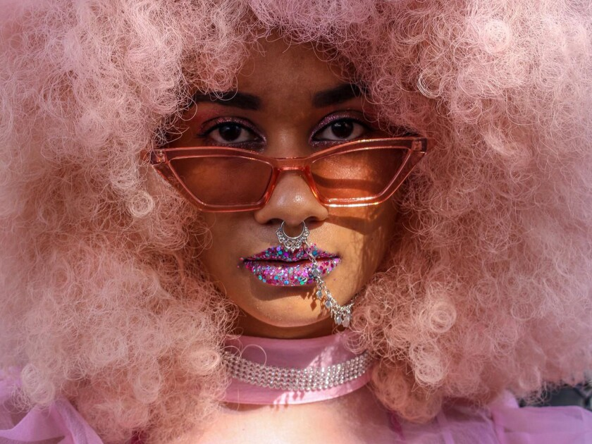 """Tahjana McCoy of London Occupation: Fashion and travel blogger Instagram: @tahjana_mccoy """"My nickname is Black Panther, but I dressed in pink and went for the Pink Panther look. I wanted to go for a cluelessly kind of look too. I dyed this wig myself."""""""