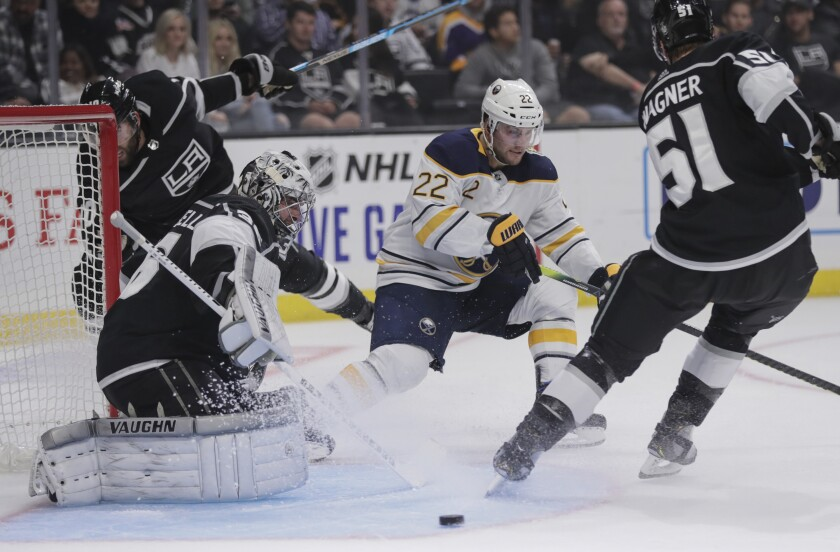 Kings goaltender Jack Campbell turns away the shot by Buffalo Sabres left wing Johan Larsson.