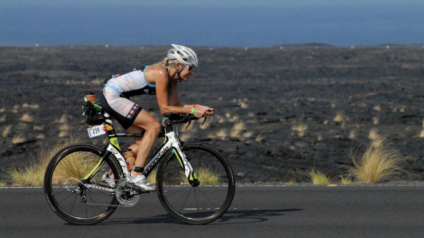 Kathleen McCartney during the biking leg of the 2013 Ironman.