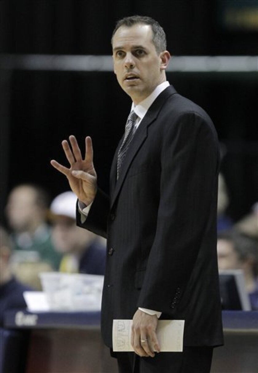 In this Jan. 31, 2011, photo, Indiana Pacers interim coach Frank Vogel gestures during an NBA basketball game against the Toronto Raptors in Indianapolis. The Pacers scheduled a Wednesday, July 56, news conference with Vogel amid speculation that he will be the next head coach of the team he led to an encouraging finish last season. Vogel will be joined at the news conference by Larry Bird, the Pacers' president of basketball operations. (AP Photo/Michael Conroy)
