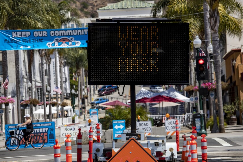 """Sign reading """"wear your mask,"""" in the city of Ventura"""