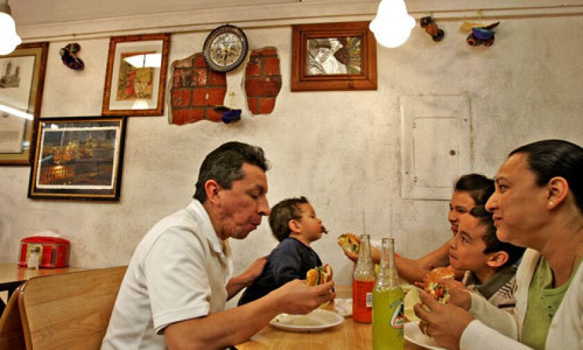 DIGGING IN: The Flores family from Lancaster enjoys their cemitas at Cemitas Poblanos Don Adrian restaurant in Van Nuys.