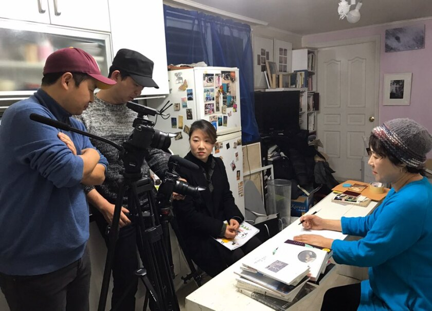 The poet Shin Hyun-rim is interviewed in his semi-basement house in central Seoul.